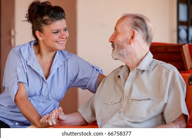 elderly man with nurse carer or granddaughter.