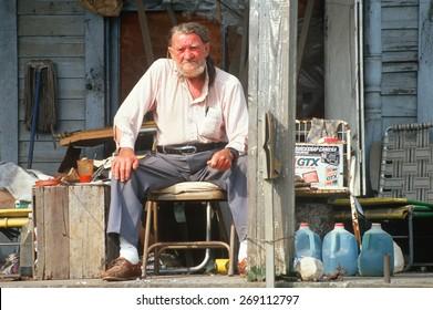 An elderly man on his front porch, Appalachia, VA