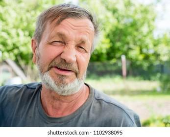 Elderly man on nature close-up portrait