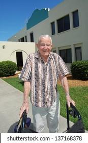 Elderly man outside assisted living center.
