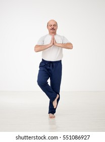 Elderly man practicing yoga or fitness. Positive mood on sports