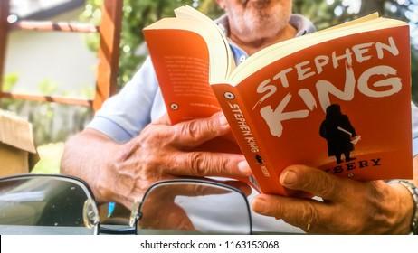 Elderly Man Read Stephen King Misery Book in Sassello,Italy-August 2018