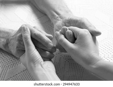Elderly man. Senior man, woman with their caregiver at home. Concept of health care for elderly old people, disabled. Black and white.