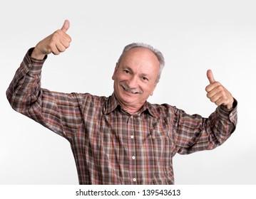 Elderly man shows ok sigh on a white  background
