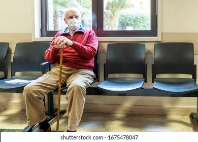 elderly man sitting in doctor's office in a hospital with respirator