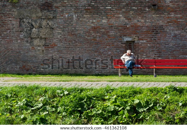 Elderly Man Sleeping on Bench in Ulm, Germany