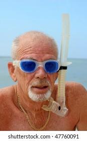 Elderly man with snorkel gear