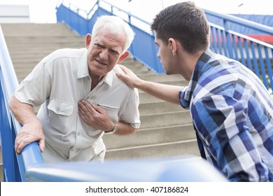 Elderly man suffering from strong pain in chest
