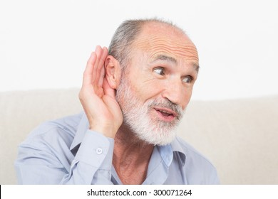 Elderly man with a symbol picture for listening