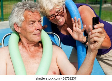 Elderly man is taking a picture for the vacation memories