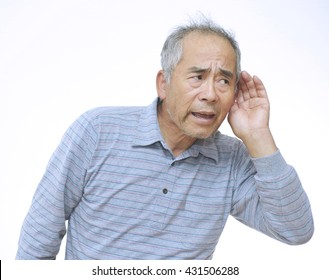 A elderly man trying to hearing the sound around him