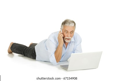 elderly man using laptop and mobile