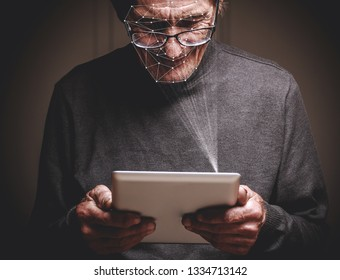 elderly man using new smartphone with face id technology