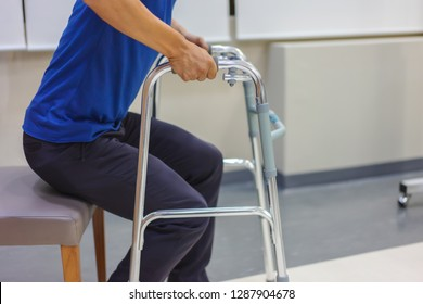 Elderly man is using the walker to support himself. Medical and healthcare concept