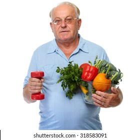 Elderly man with vegetables and dumbbell isolated over white background.