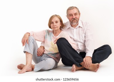 Elderly man and woman on a light background. Studio photography/Happy elderly couple