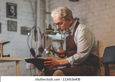 An elderly man at work in the workshop