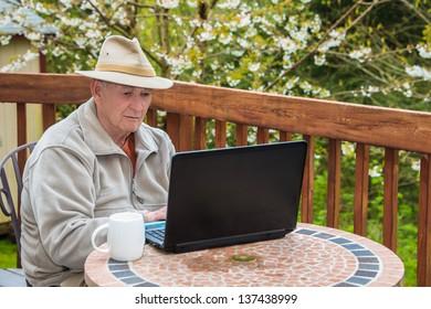 Elderly Man Working on Laptop Computer