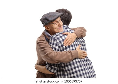 Elderly man and a young man hugging each other isolated on white background