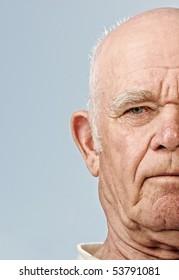 Elderly man's face over blue background