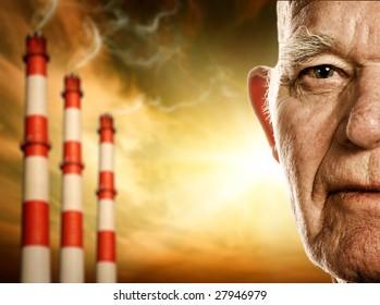 Elderly man's face. Power plants on background