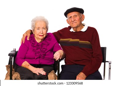 Elderly married couple on a white background.