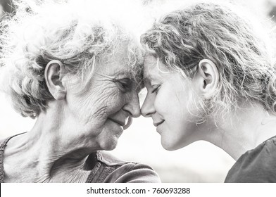 Elderly mother and daughter face to face