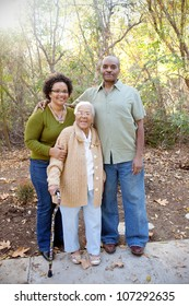 An Elderly Mother with Daughter and Son In-law