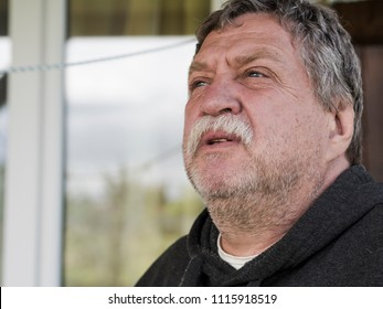 Elderly moustached fat man