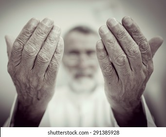 Elderly Muslim Arabic man praying