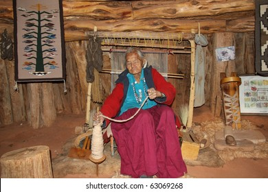 elderly navajo woman demonstrating weaving