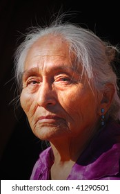 Elderly Navajo woman with light shining on her face