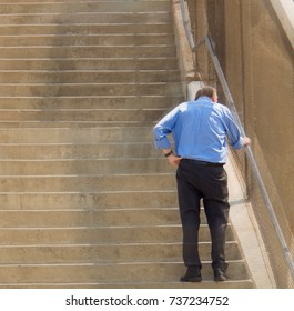 Elderly old man climb stair fatigue and tired from exercise
