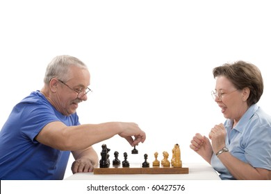 The elderly pair playing chess on white background