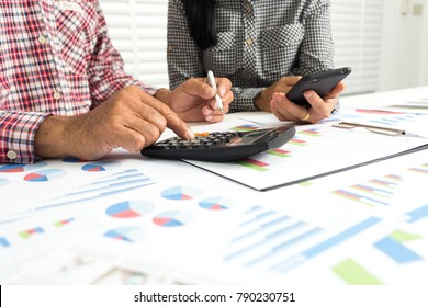 Elderly parents are helping to calculate household expenses. To save money