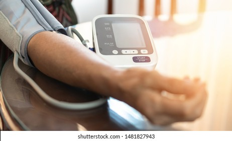 Elderly patient with bp, heart rate, digital pulse check equipment for medical geriatric awareness in stroke systolic high blood pressure, hypertension and cardiovascular disease in aged woman person
