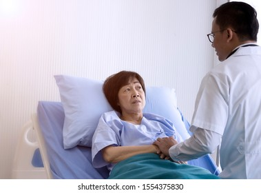 Elderly patient care concept; Asian doctor is taking care elderly patient woman in hospital.
