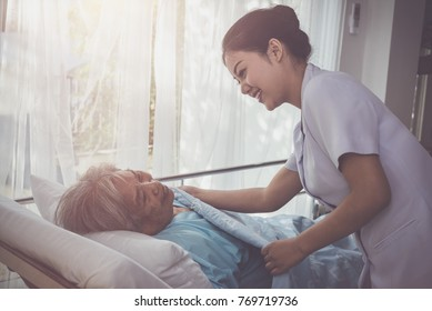 Elderly patient lying on Hospital bed with nurse consulting for encouraging in treatment at hospital ,medicine, health care and old people concept