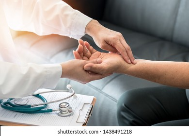 Elderly patient pulse check by medical geriatric doctor for awareness in stroke systolic high blood pressure, hypertension, hypotension and cardiovascular disease in aged senior older woman person
