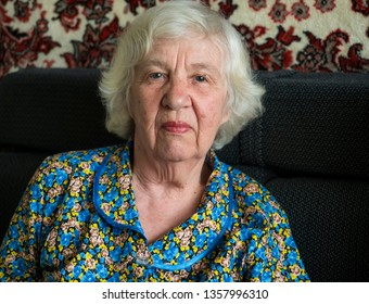 Elderly pensive woman face