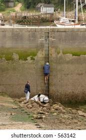 elderly people climbing a wall