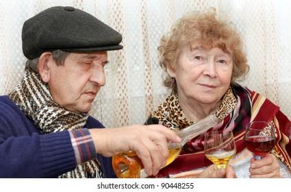 Elderly people drinking