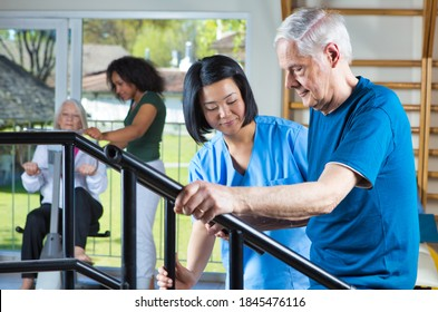 Elderly people at the gym making physical exercises.