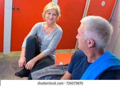 elderly people having conversation in locker room