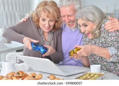 Elderly people playing computer game
