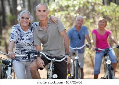 Elderly people riding their bikes