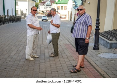 Elderly people walk the streets of the city. Minsk, Belarus