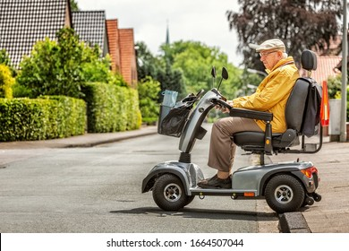 An elderly person drives an electric vehicle