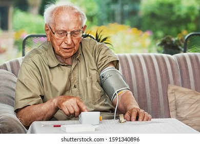 Elderly Person Measuring Blood Pressure with Sphygmomanometer