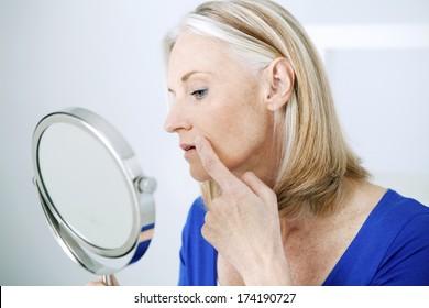 Elderly Person With Mirror